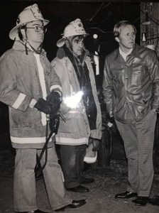 """Pictured below from L-R is 2nd Assistant Chief James """"Jim"""" Clarkson, 1st Assistant Chief J. William """"Bill"""" Hershey, and Fire Chief D. Earl Bouder. This photo was taken at the scene of an incident in 1979."""